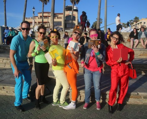 group of adults dressed like the eighties for team building scavenger hunt