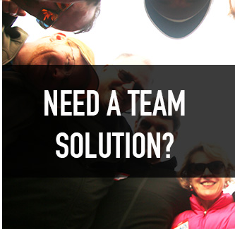 white text over image of team building group