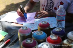 Graffiti artist writing tag names for team building event