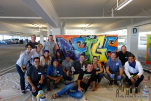 team building graffiti group photo