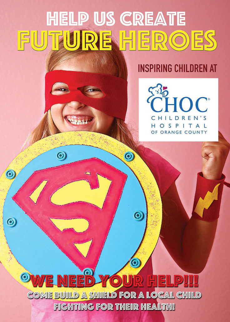 corporate team building super hero kits girl holding shield