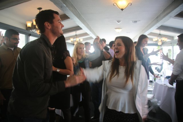couple laughing at corporate networking event for team building