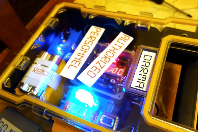 glowing device labelled authorized personnel for team building event