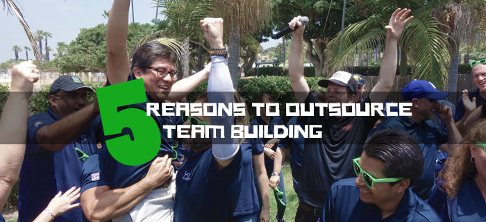 group cheering 5 reasons to outsource team building