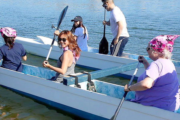 Corporate team building outrigger canoe paddling event