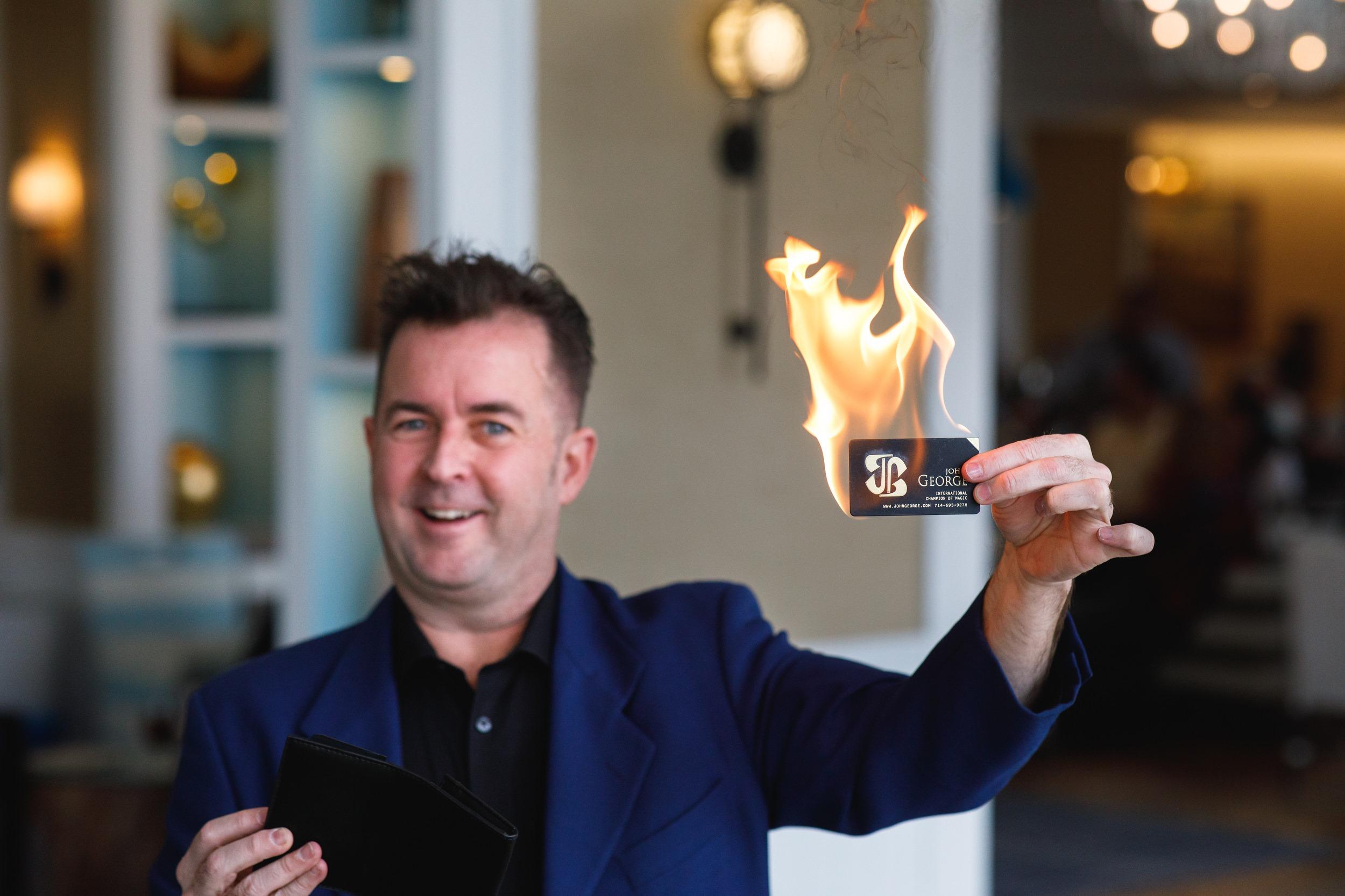 magician burning business card
